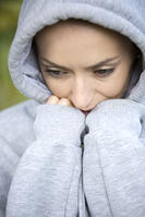 Young woman on a cold morning in a hooded top before going out for a run-2